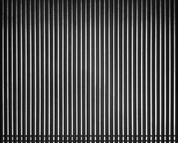 Escalator floor with copy space.Vertical pattern.striped metallic lines abstract background which has black and white.