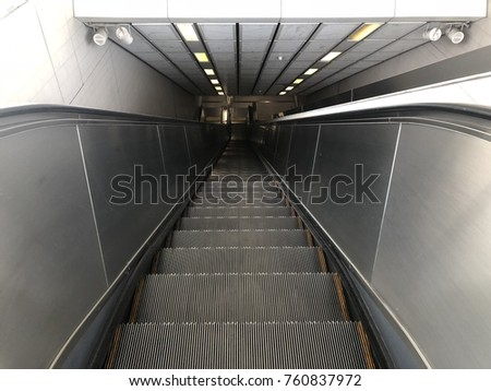 Escalator move down to the subway in bangkok thailand #760837972