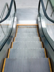 escalator step with yellow line at side