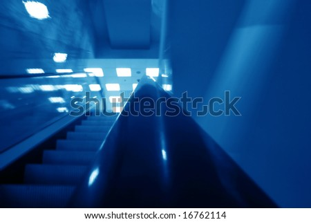 escalator transportation motion blured business background