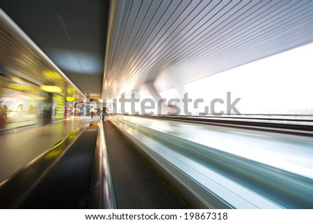 Escalator with motion blur effect in some modern building. - stock photo