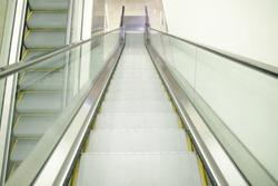 Escalators at community malls, shopping centers, or department stores. Modern Escalators