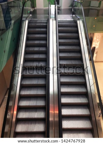 Escalators in a shopping mall. Moving stairways. #1424767928