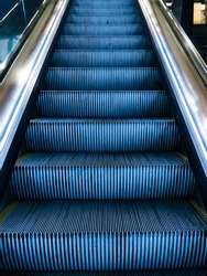 Escalators inside an airport in the world. Escalator system to go up or down mechanically.