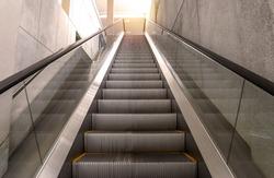 escalators stairway inside modern office building.