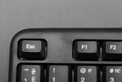 Escape button on the keyboard closeup, top view