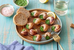 Escargots de Bourgogne. Snails with herbs butter. Healty eating. French food