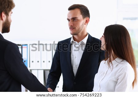 Escort service interpreter works with the transaction accompanies documents conclusion of the contract important situation. Arab businessman and his translator welcome business partner and says hello #754269223