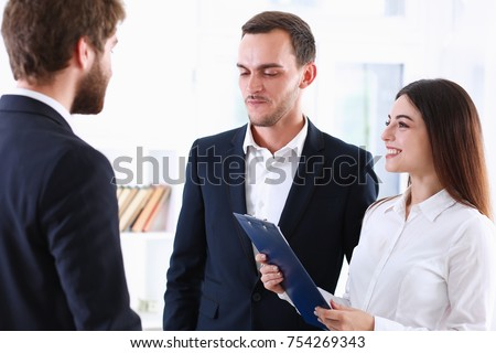 Escort service interpreter works with the transaction accompanies documents conclusion of the contract important situation. Arab businessman and his translator welcome business partner and says hello #754269343