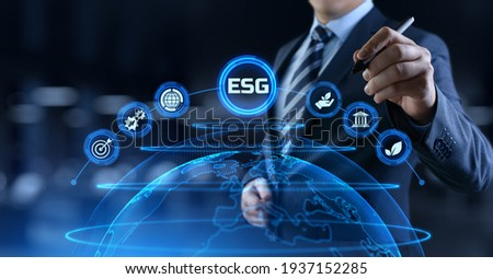 ESG environmental social governance business strategy investing concept. Businessman pressing button on screen.
