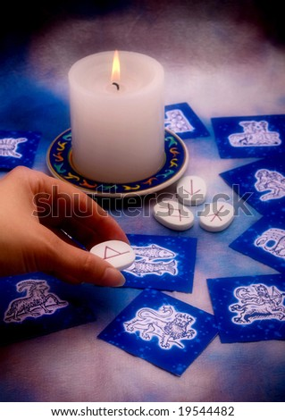 esoterism concept with runes astrological cards and candle