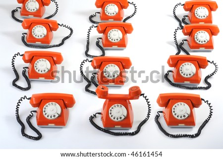 Especial phone looks forward to hearing. Close up large group of orange telephones