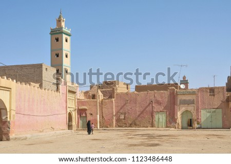 Esplanade and mosque minaret in the city of Erfoud, in southern Morocco