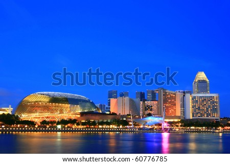 Esplanade public theater called as Durian Building and skyscraper at dusk - stock photo