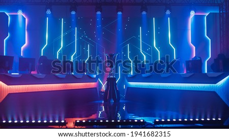 eSports Winner Trophy Standing on a Stage in the Middle of the Computer Video Games Championship Arena. Two Rows of PC for Competing Teams. Stylish Neon Lights with Cool Design. Photo stock ©