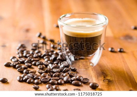 Espresso and roasted coffee beans.