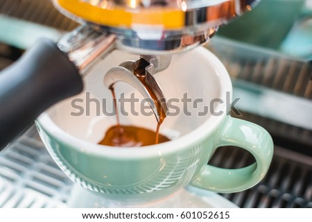 espresso brewing from espresso machine #601052615
