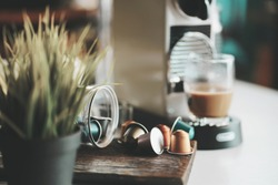 Espresso coffee capsules and Capsule coffee machines on white desk at office .selective focus