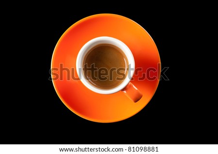 Espresso coffee in a cup of orange on a white background, top view