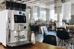Espresso coffee machine in the loft office