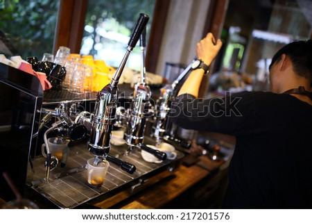 Espresso coffee machine with barista working