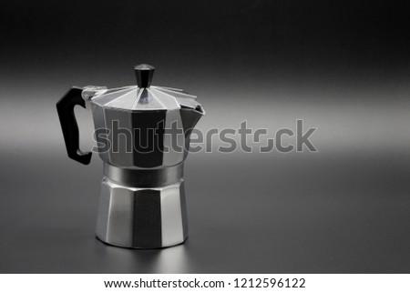 Espresso Coffee maker on dark background. #1212596122