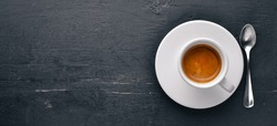 Espresso coffee On a wooden background. Top view. Free space for your text.