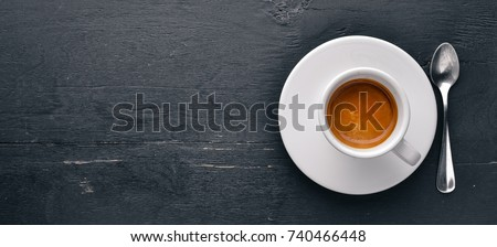 Espresso coffee On a wooden background. Top view. Free space for your text. #740466448