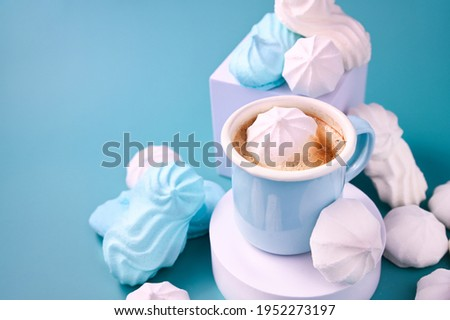 Espresso cup with foam. Meringues of different colors on a blue background and Coffee. Meringue. A creative shot of protein and sugar cookies. High quality photo. Copy space ストックフォト ©