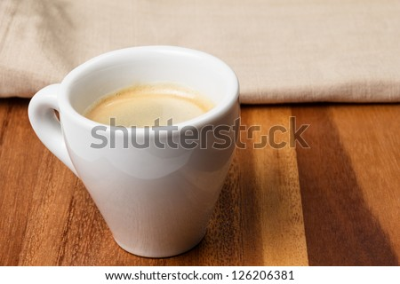 espresso in a cup on burlap surface