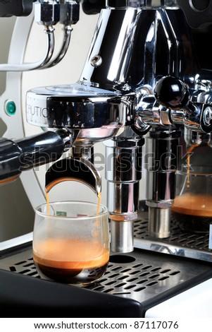 espresso machine making coffee to cup.