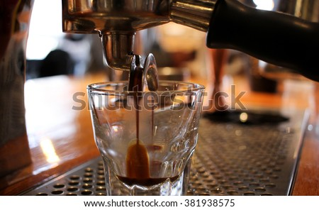 Espresso Machine Making Espresso  #381938575
