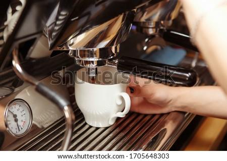 Espresso machine pouring coffee in cups. Barista making fresh coffee latte. Stok fotoğraf ©