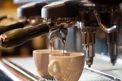 Espresso machine working with bar interior background