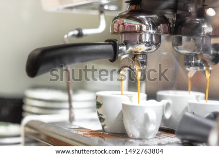 Espresso pouring from espresso coffee machine. Hot beverages. Two espresso pouring from espresso coffee machine. Hot beverages, coffee preparation and barista . #1492763804