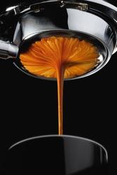 Espresso shot from espresso machine dark background