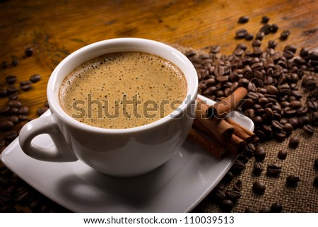 espresso with cinnamon sticks on wooden table