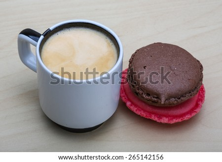 Espresso with two macaroons on the wood background #265142156