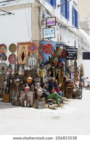 ESSAOUIRA, MOROCCO - MAY 14, 2014: Local artists selling their crafts in street on sunny day. Essaouira, Morocco. May 14, 2014.