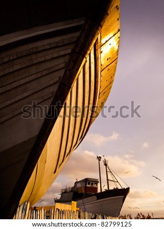 Essaouira, Morocco: Wooden hull of boat at sunset in shipyard dry-dock, Essaouira, Morocco