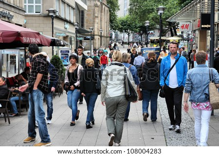ESSEN, GERMANY - JULY 17: People shop downtown on July 17, 2012 in Essen, Germany. Essen is a city of almost 600 thousand citizens and was the 2010 European Capital of Culture.