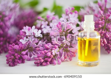 Essence of flowers on a table in a beautiful glass jar #690409150