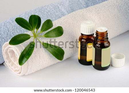 Essential oil bottles and towels