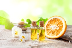 Essential oil of mandarin on a wooden table - healing aromatic oil