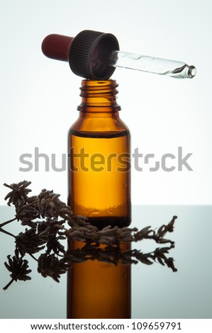 essential oil with lavender flowers