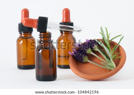 essential oils and lavender flowers with rosemary