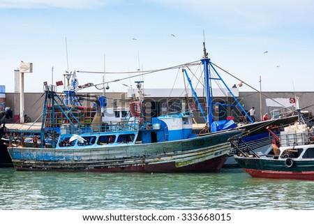 ESSOUIRA, MOROCCO - OCT 2, 2015: Fishing boat in the port on the coast of Essouira, Morocco. The city was called Sidi Megdoulin in 11th-century #333668015