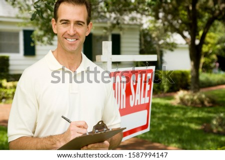 Estate agent outside property for sale