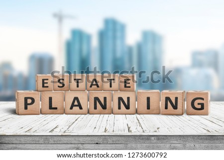 Estate planning sign on a wooden pier with tall buildings in the background #1273600792