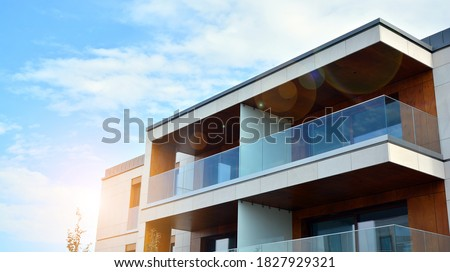 Estate property and condo architecture. Fragment of modern residential flat with apartment building exterior. Detail of new luxury home complex.